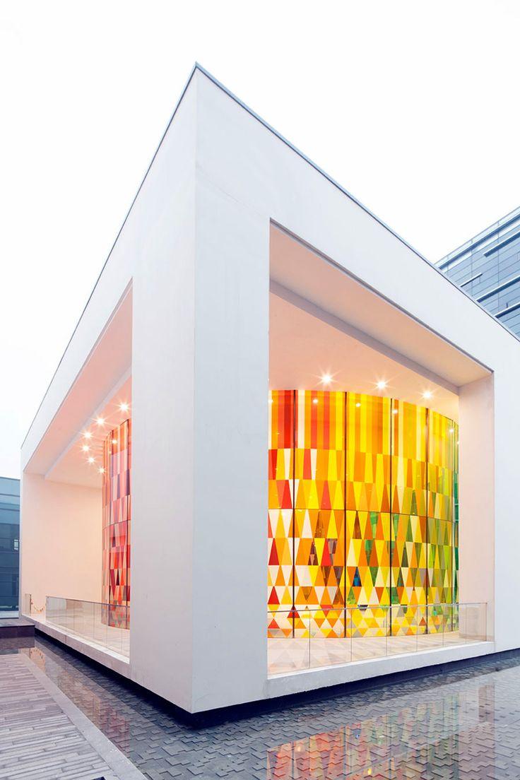 coordination asia's rainbow chapel features kaleidoscopic façade