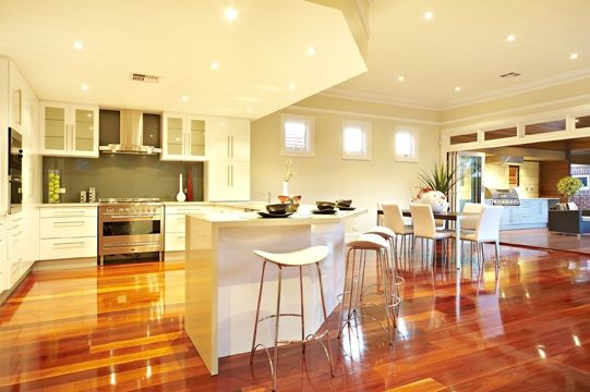 Classic white kitchen with breakfast bar, gleaming floorboards. #mtlawley #allclass #renovation #homeaddition #perth
