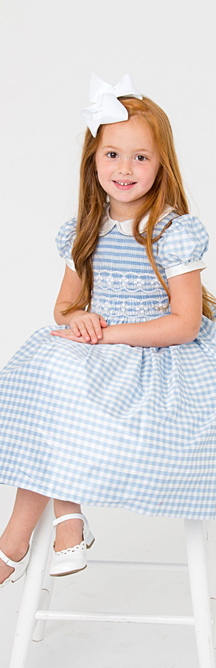 Fine Hand Smocked Dresses for girls. only at www.marcoandlizzy.com