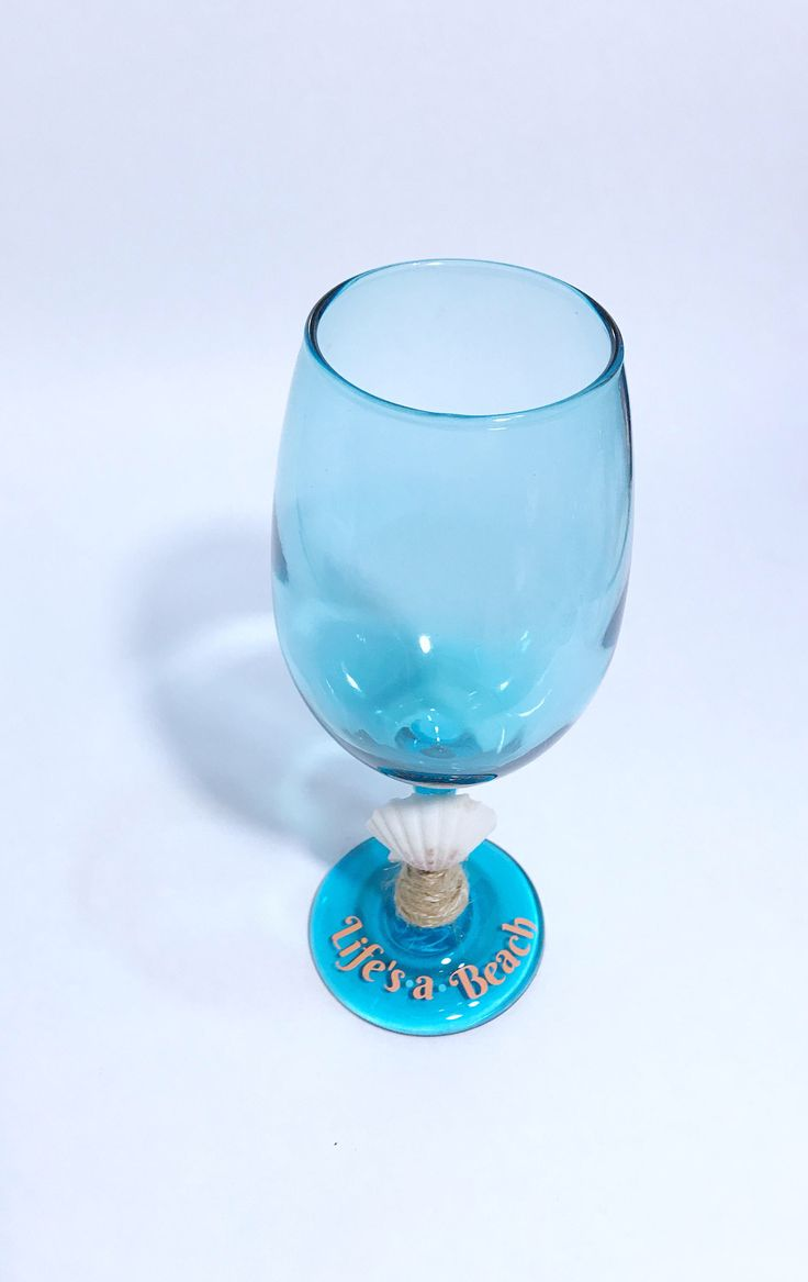Beach wine glass beach wine glasses with shell and quote Life's a Beachwine glass cute mermaid inspired wineglass clam shell blue wine glass by CraftyCassondra on Etsy https://www.etsy.com/listing/533796121/beach-wine-glass-beach-wine-glasses-with