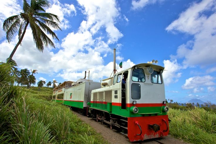 "In St. Kitts, we're boarding the St. Kitts Scenic Railway. This unique ""island tour"" runs in a complete circle around St. Kitts allowing visitors the opportunity to see the entire country by rail and highway in only three hours."