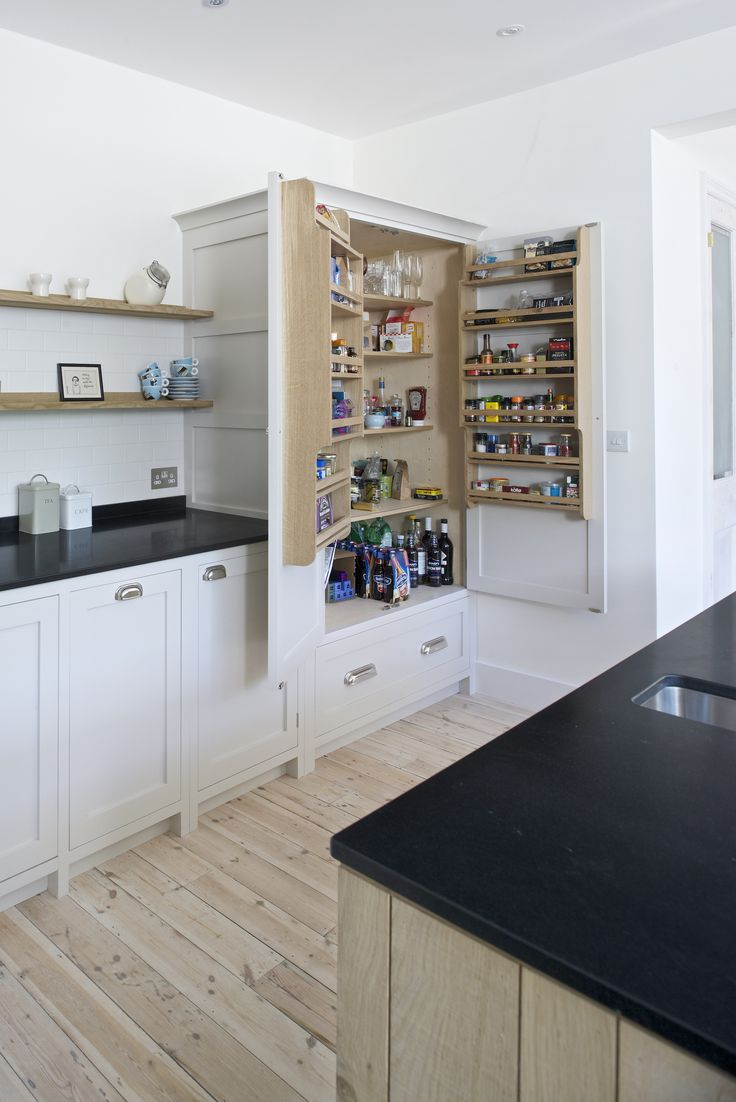 A view of the pantry, or larder, for all your kitchen essentials. Food and crockery storage such as this can really help to get us feeling organised in the kitchen.