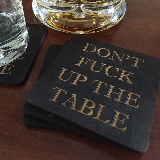 """Don't F**k Up The Table CoastersWhenever you hand somebody a coaster this is what you are really saying. """"Don't Fuck Up The Table!"""" These witty and fun coasters are handmade out of baltic birch wood. Each piece is then hand stained and laser etched. They work great, make a fantastic conversation piece, and are just super fun and clever. Each coaster measures 4"""" x 4"""" and is 1/4"""" thick. Each order consists of 4 wood coasters."""