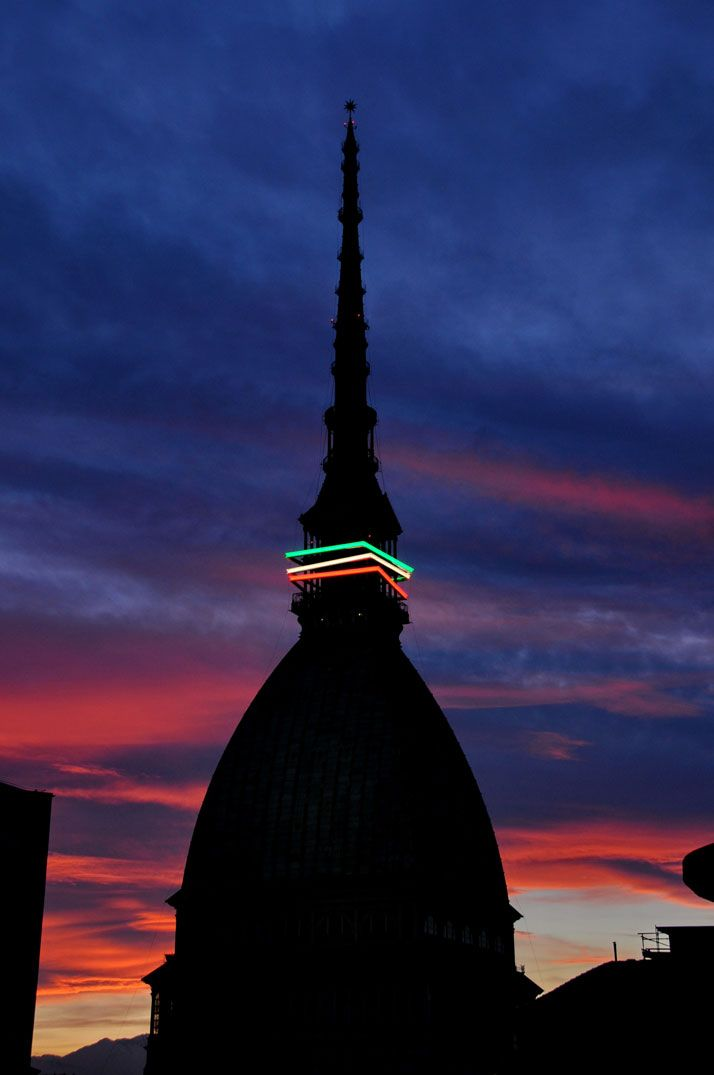 'Mole Antonelliana' adorned with three rectangular steel frames in red, white and green LED lights   Discover and collect amazing bucket lists created by local experts. #Torino #travel #local #bucket #list #bucketlist  www.cityisyours.com/explore