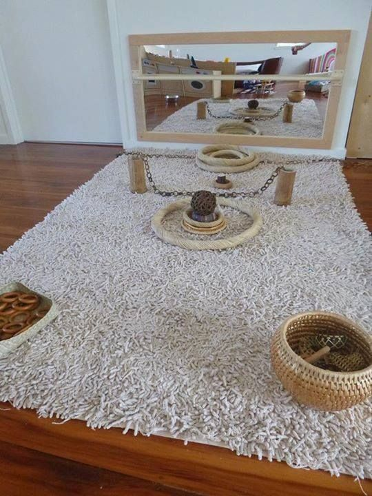 Infant exploration. Baskets and interesting displays of simple inactive natural objects.