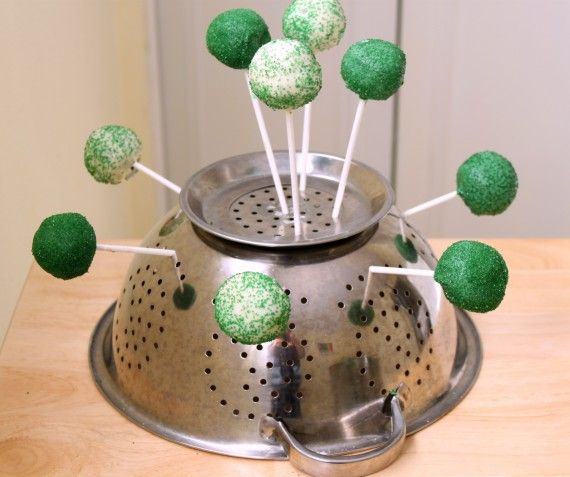 Use a colander to dry cake pops  ... Helpful article with more tips for making cake pops easier to make!