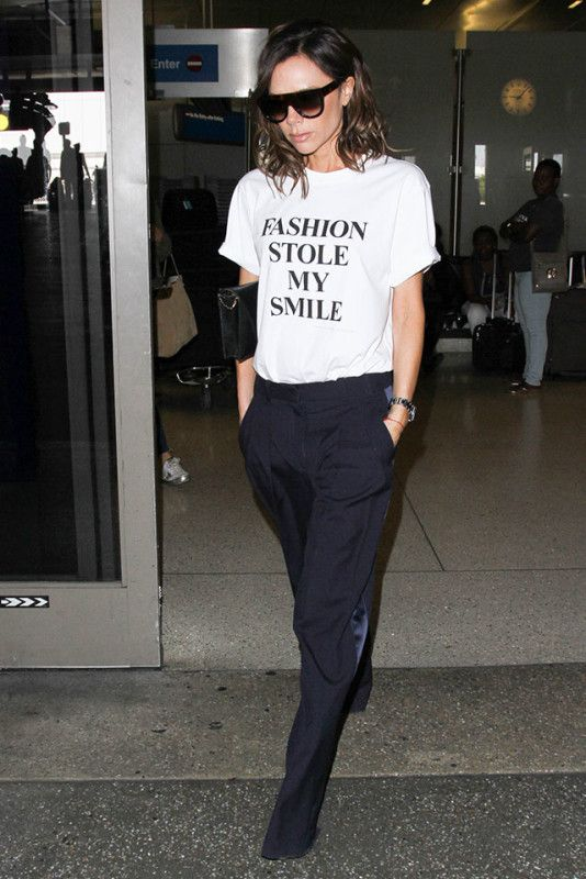 Victoria Beckham steps out in a T-shirt with slogan 'Fashion Stole My Smile'
