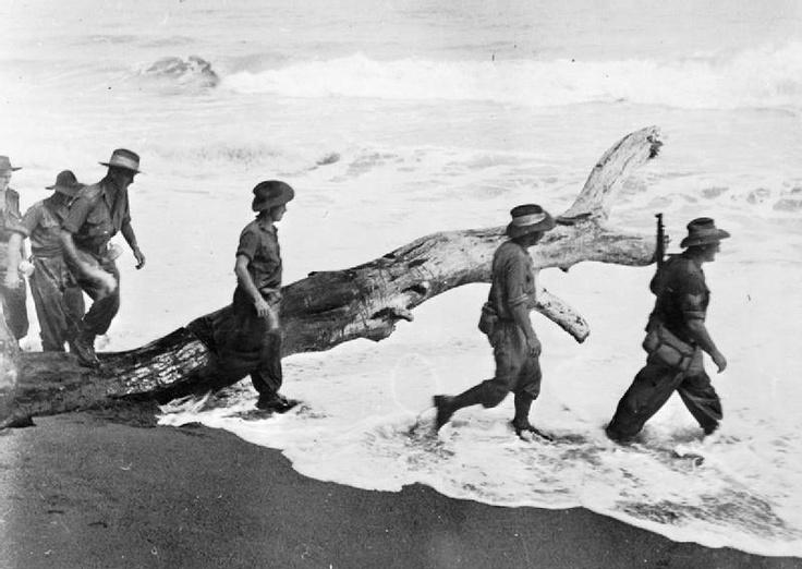 The Campaign in New Guinea, December 1942 - 1943: Australian soldiers advance along the coast toward Salamaua.