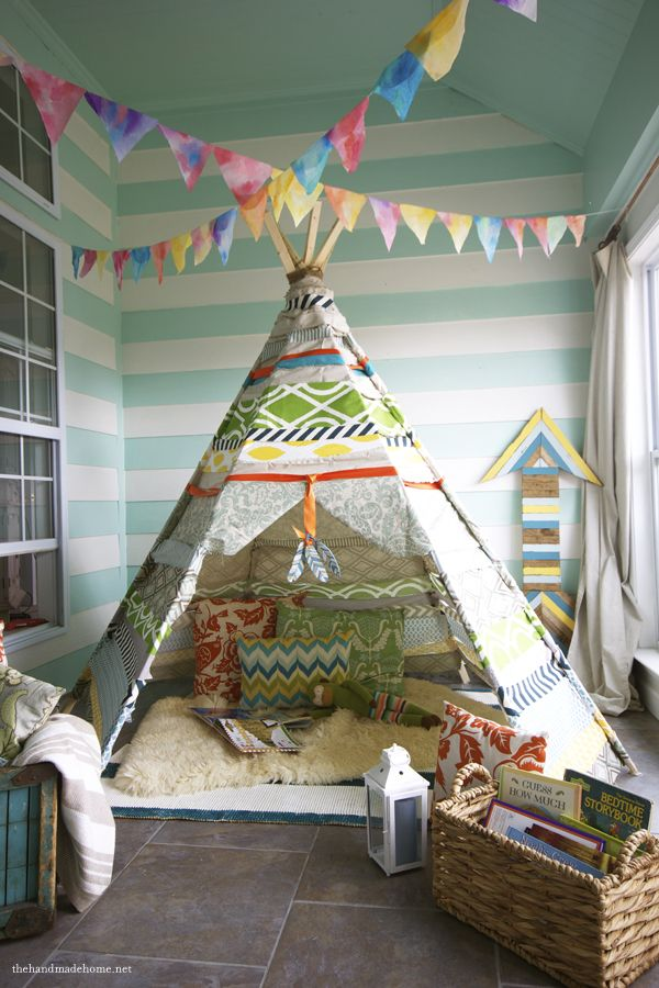 This is just the coolest idea!  I love the teepee set up and it's so easy!  So this next weekend I am going to pick up the wood for one and we can set it up in the back yard.  I also love the wooden arrow behind it in the picture and we may try to make one of those as well.  Great place to read!  This is perfect for a summer party!