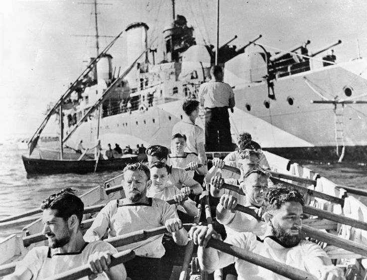 Australian sailors row to their ship, the cruiser HMAS PERTH, on duty with the British fleet in the Mediterranean. Soon after, PERTH went to the Far East where she was sunk by the Japanese off Java on 1 March 1942.