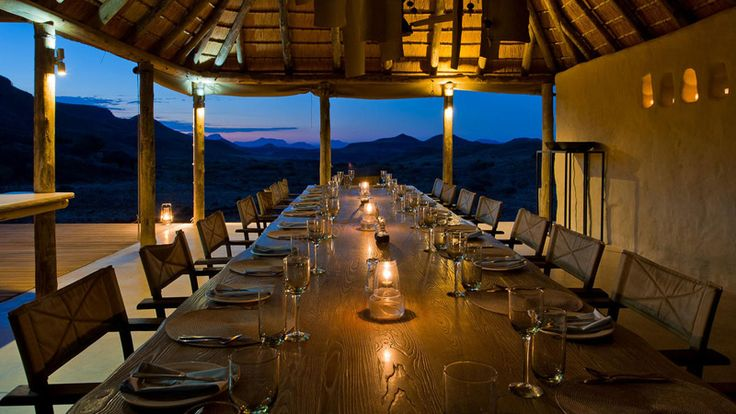 Dine in the desert at Damarland Camp on our 10 Day Luxury Namibia Safari #luxurytravel #namibia