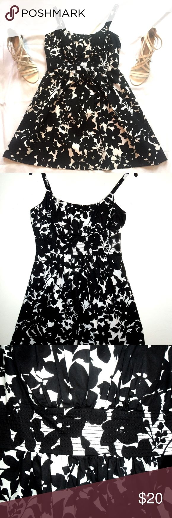 "FLORAL BLACK AND WHITE SUNDRESS Flattering BLACK AND WHITE FLORAL SUNDRESS with adjustable SPAGHETTI STRAPS. Cute ruched neckline and bust design and a decorative empire waist band with black stitching. Bust has a slightly padded bra. Back zip. Fabric has some stretch.CONDITION: This dress was bought new, worn once, and dry cleaned and then stored. Looks new! No Defect or visible signs of wear. L-30"", BUST-40"",WAIST-34"",Hips-not fitted,flare;closure-back zipper-13"". Care: machine wash cold…"