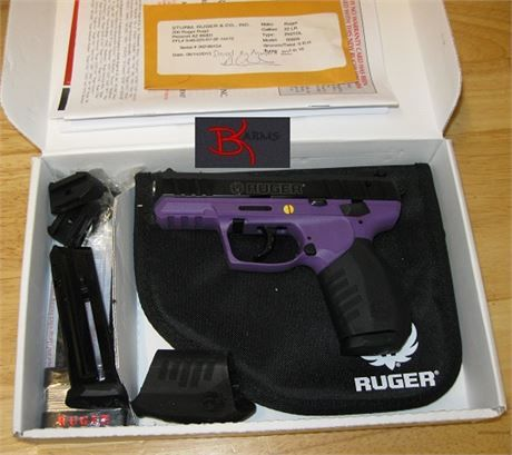 FREE SHIPPING to CONUS! Manufacturer: Ruger. Model #: SR22-PG Ruger Lady Lilac TALO Edition. Type: Pistol: Semi-Auto. Finish: Black Anodize. Stock: Purple Synthetic. Sights: Front: Ramp 1 Dot Rear: Adjustable 2 Dot. Barrel Length: 3.5. Overall Length: 6.4. Weight: 17.5 oz. Caliber: 22LR. Capacity: 10+1. Action: Double Action. # of Mags: 2. Packaging: Cardboard Box, Black Zipper Case. Receiver: Purple Polymer W/ Picatinny Rail. Features: Magazine Disconnect, Loaded Chamber Indicator, Int...