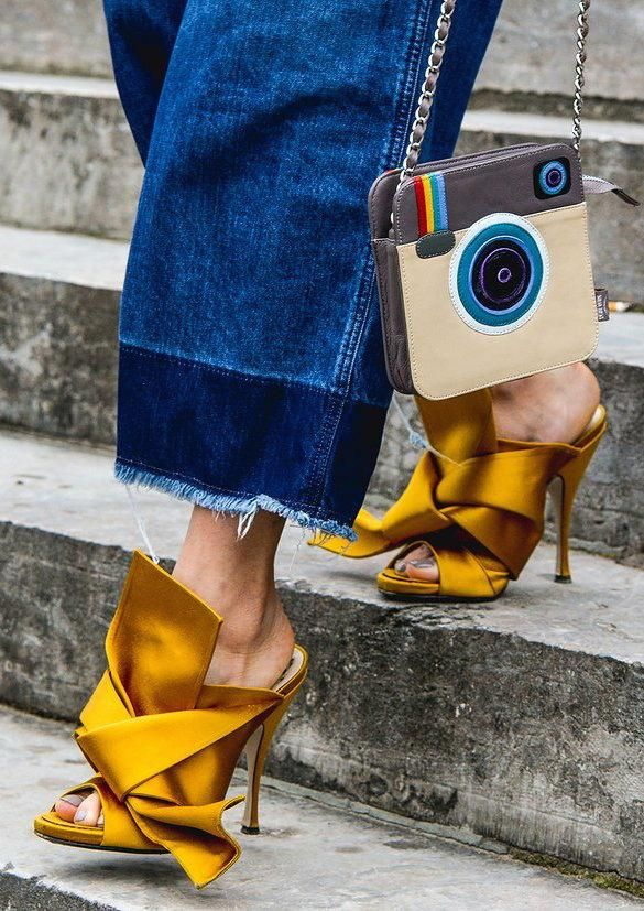 Raw hem denim, gold knotted heels, Instagram purse