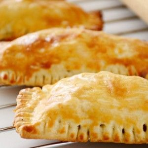 The handheld meat pie may be one of the most universal of foods, with almost every culture offering its own take on a little pastry stuffed with a savory, meaty filling. And it's no wonder....
