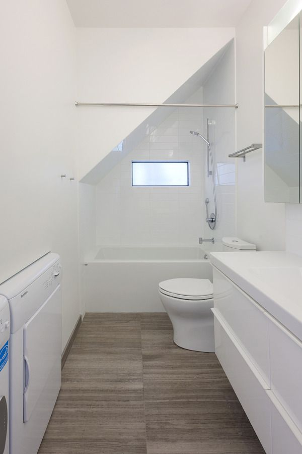 Tub under stairs    lanefab 800 sf small house at 20th highbury 0013 Simple Living in an 800 Sq. Ft. Small House