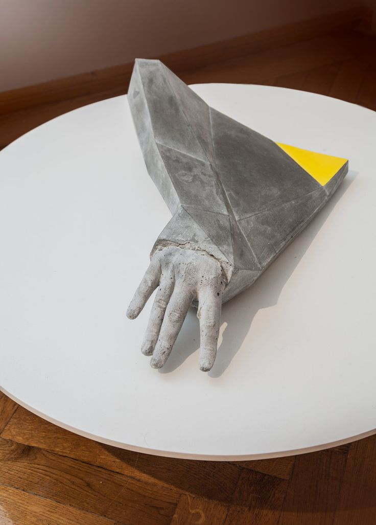 Radu Cioca - Yellow Triangle (2013) Concrete/ Metal/ Pain/ Wood 74 x 74 x 30 cm