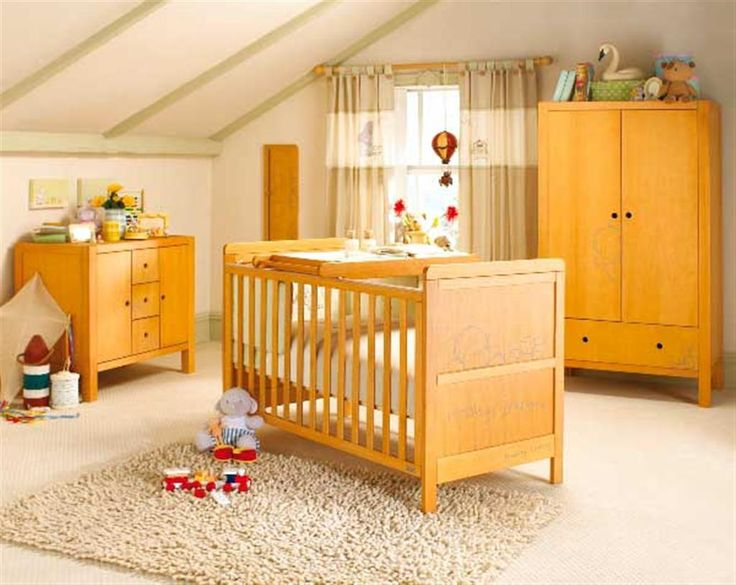 Colorful Baby Room Interior With Sloped Ceiling And Wooden Cabinets Drawer White Fur Rug