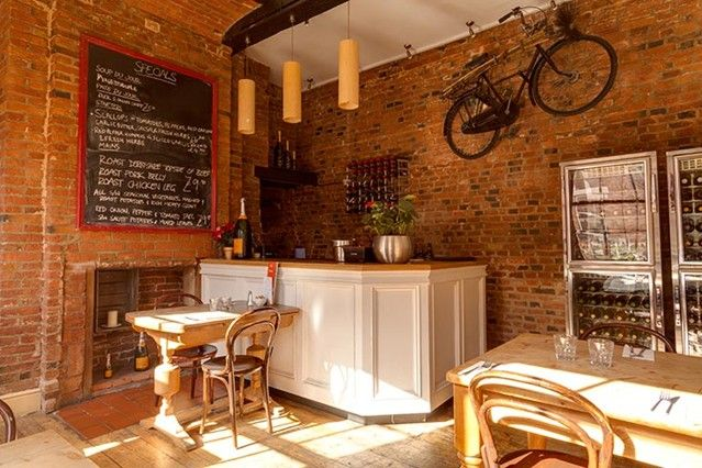 Le Mistral (Nottingham) Restaurant Nottingham. French design with mounted bicycle.