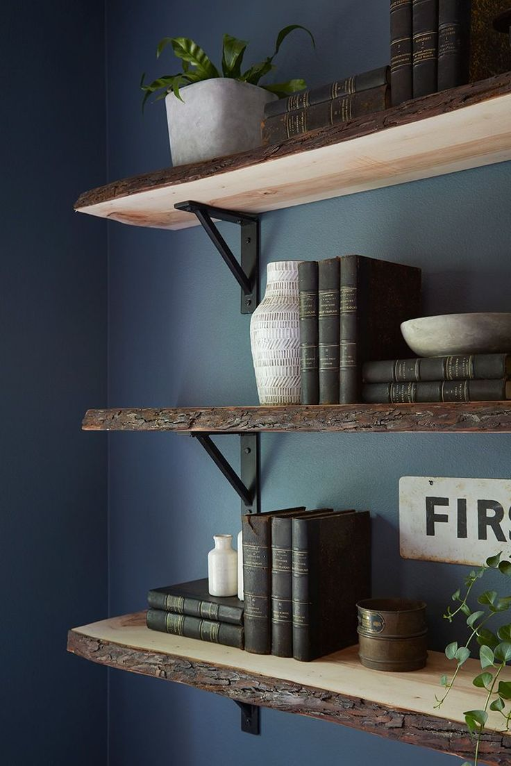 The live-wood edge on the floating shelves created a masculine look that gave this office even more personality.