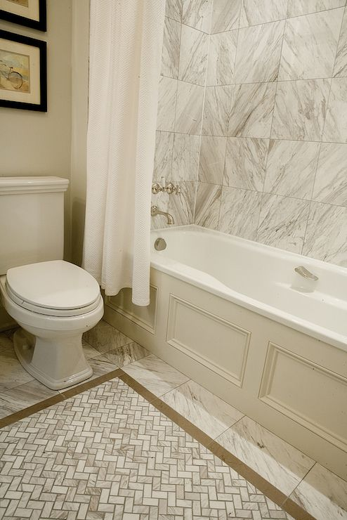 Elegant Bathroom With Marble Tile Over Shower/tub Combo Paneled In  Wainscoting And Dressed With A Simple White Shower Curtain. Pictures