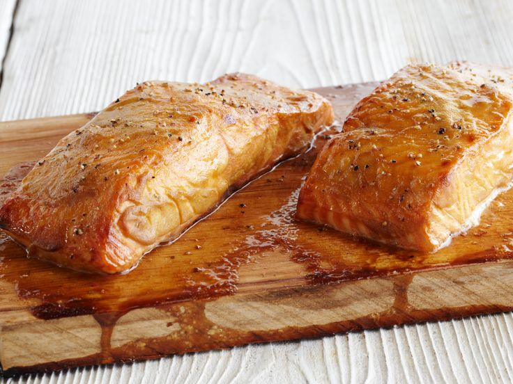 Grilled Cedar Plank Salmon - Steve Raichlen * SOAK PLANKS IN SALTED WATER FOR 2 HOURS * 1 cedar plank (6 by 14 inches) 2 salmon fillets (1 1/2 pounds total) Salt and freshly ground black pepper 6 tablespoons Dijon mustard 6 tablespoons brown sugar