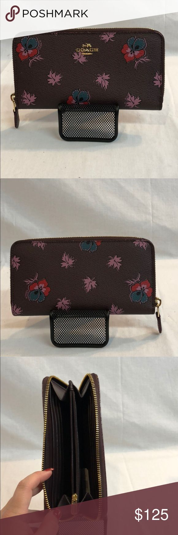 """Coach wallet F15155 ACCORDION ZIP WALLET IN WILDFLOWER PRINT COATED CANVAS (COACH f15155) LIGHT GOLD/OXBLOOD 1 Details Printed coated canvas Twelve credit card slots Full-length bill compartments Zip coin pocket Zip-around closure 7 1/2"""" (L) x 4"""" (H) Fits all phone sizes up to an iPhone 7 Plus and Samsung S7 Edge Coach Bags Wallets"""