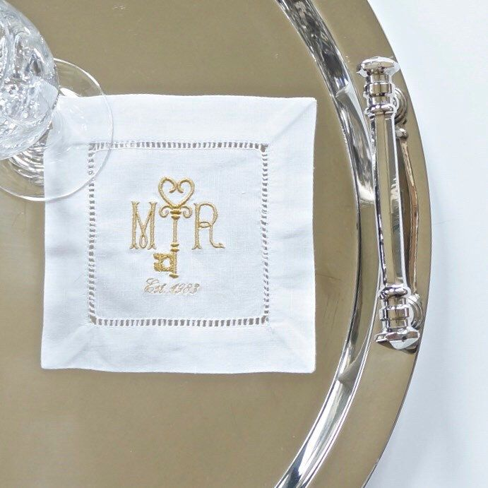 Monogrammed key design is perfect for weddings and special events. Available for cocktail napkins, dinner napkins and guest towels. Choose event date or year. Select from more than 100 colors.
