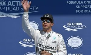 Lewis Hamilton waves to the crowd at Spa-Francorchamps after securing pole position for the Belgian Grand Prix.