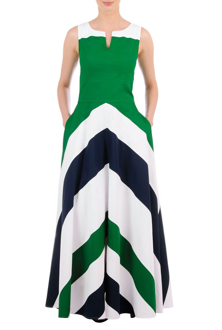 Contrast tones vitalize our fifties fit-and-flare dress styled with a notched neckline and banded chevron stripes at the full flared skirt.
