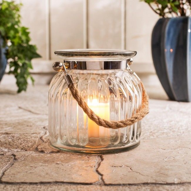 Brighten up your next backyard party or evening at the cottage with these colourful glass lanterns. Heavy glass construction won't blow over in a breeze and features a decorative rustic rope handle.