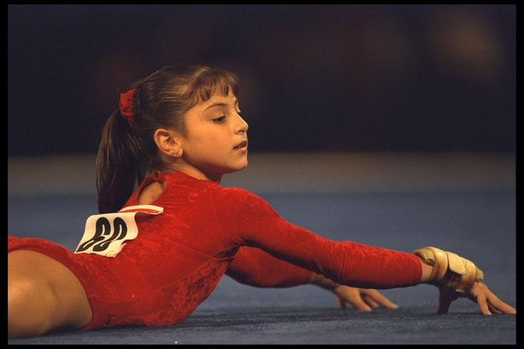 1 of 19 18 Aug 1995: Dominique Moceanu perfoms the floor excercise during the optionals of the U.S. National Gymnastics Championships at the Superdome in New Orleans, Louisiana. Mandatory Credit: Doug Pensinger/Allsport