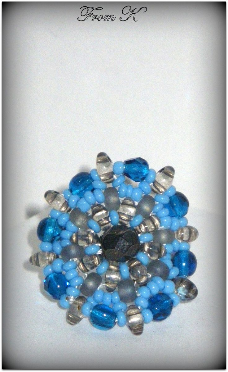 """style ring designed to make you stand out in the croud. Sophisticated enough for formal occasions and fun enough for casual time. Approx 4 cm round. Czech seed beads and special """"twin"""" beads are used here. For more photos, prices and other info, please visit my facebook page https://www.facebook.com/media/set/?set=a.255836934442612.81617.246629745363331&type=3"""