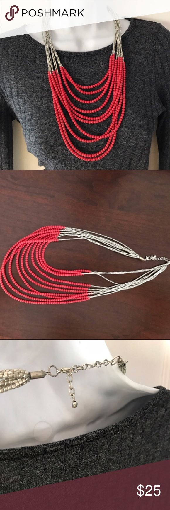 Cost Plus Multi-Strand Red Beaded Necklace 10 strands of red and silver beads make this layered beauty a showstopper. The necklace hangs about 10 inches from the first tier but the clasp is adjustable. Cost Plus World Market Jewelry Necklaces