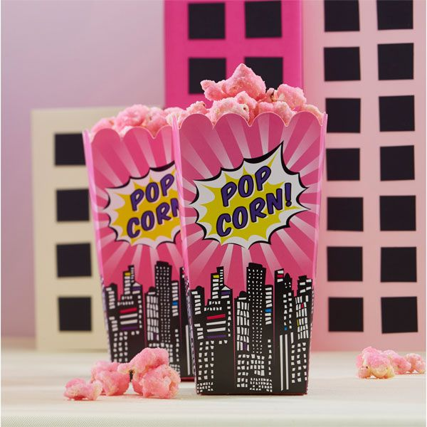 Popcorn is the perfect party food for a pop art superhero party theme! Serve yours in these pink pop art superhero popcorn boxes. Perfect for a pink superhero party theme.