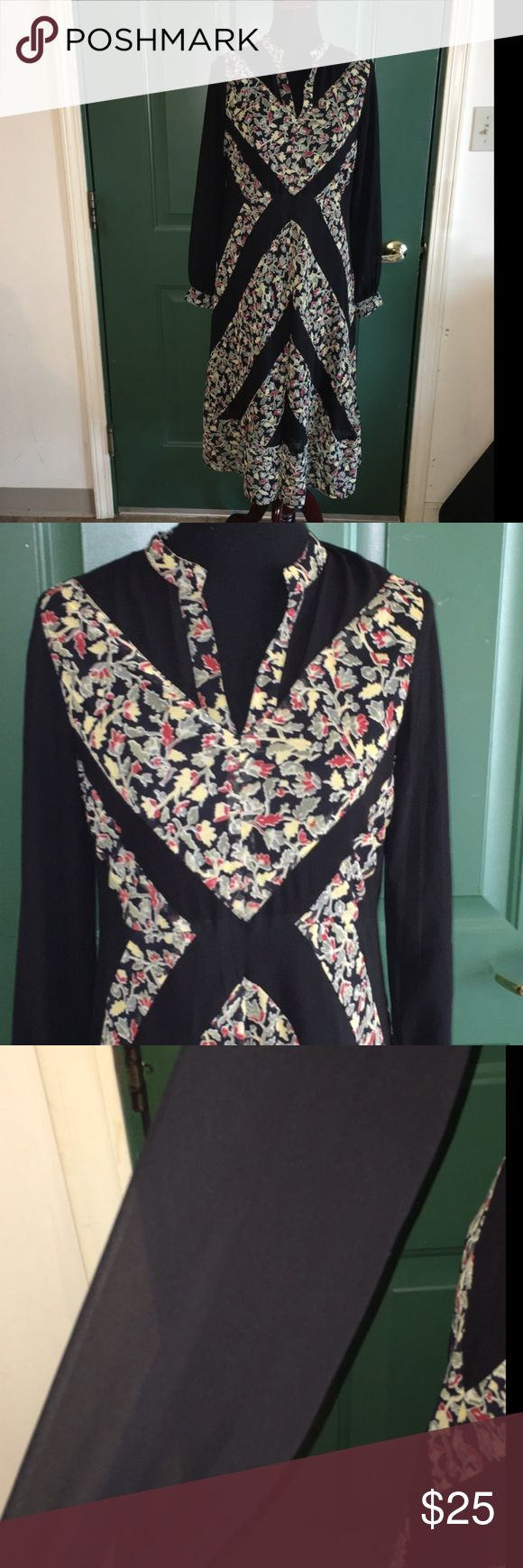 NWT Black Floral Asos Dress Size 6 New with tags!!!  Black floral maxi dress by Asos.  Long sleeves, mandarin collar.  Has solid black sheer panels inset.  Size 6. Dress is 46 inches long.   Important:   All items are freshly laundered as applicable prior to shipping (new items and shoes excluded).  Not all my items are from pet/smoke free homes.  Price is reduced to reflect this!   Thank you for looking! Asos Dresses Maxi