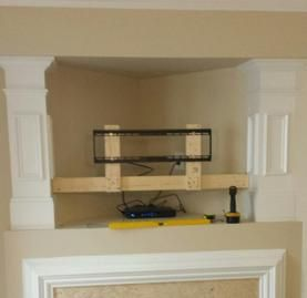 Make That Outdated Hole Above Fireplace Vanish By Installing A Flat Screen Tv Covering It Custom Mounting Over Niche