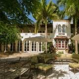 Transport yourself back to the 1920s at this completely renovated   Mediterranean  Revival home in Miami's Coconut Grove neighborhood. A rare find, this nine-bedroom mansion sits on seven acres of lushly landscaped   waterfront  property. You'll find little hideaways throughout the home, including a cozy library with a window seat that overlooks the grounds. There's even room to park a 70-foot yacht out back.  | HGTV FrontDoor
