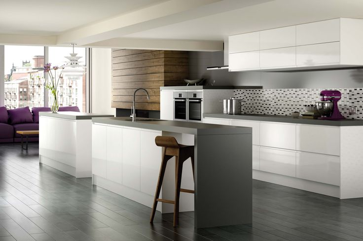 This is pretty much what we want.... the thick grey worktop, dark wood accents and the odd splash of colour.