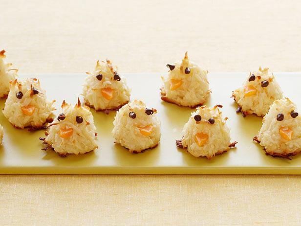 Get Lemon Macaroon Chicks Recipe from Food Network   Could  put  white chocolate under the chicks.