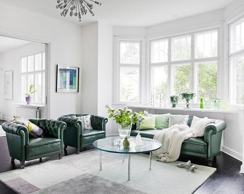 I am totally lusting over these gorgeous green leather chairs and couch