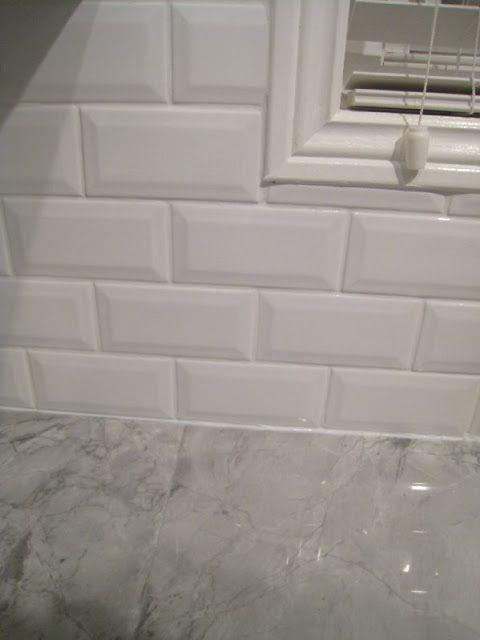 Beveled subway tiles backsplash and gray granite countertop Interior Groupie: Kitchen reveal part 3 - The backsplash