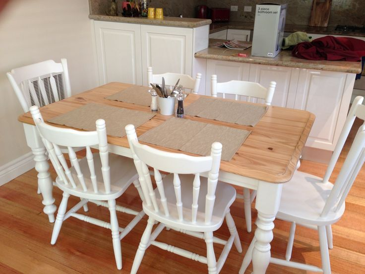 DIY refurbished pine table with a French provincial look and mismatched chairs