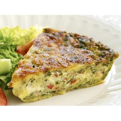 Cheese, ham and spinach impossible pie recipe - By Woman's Day, This delicious savoury pie is extremely easy to make -simply mix all ingredients together and bake. It's great enjoyed fresh out of the oven with a side salad, or cut up and chilled for school or work lunches.