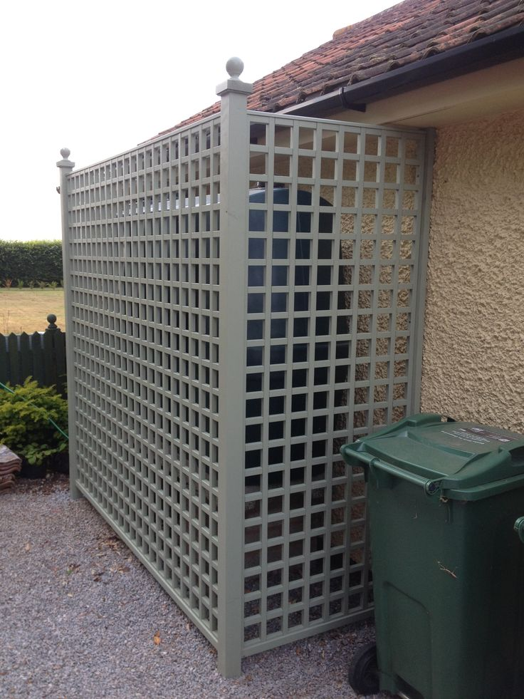 Trellis Direct square trellis as screening for oil tank, this would disguise the oil tank at the back would last longer than wicker fence panels