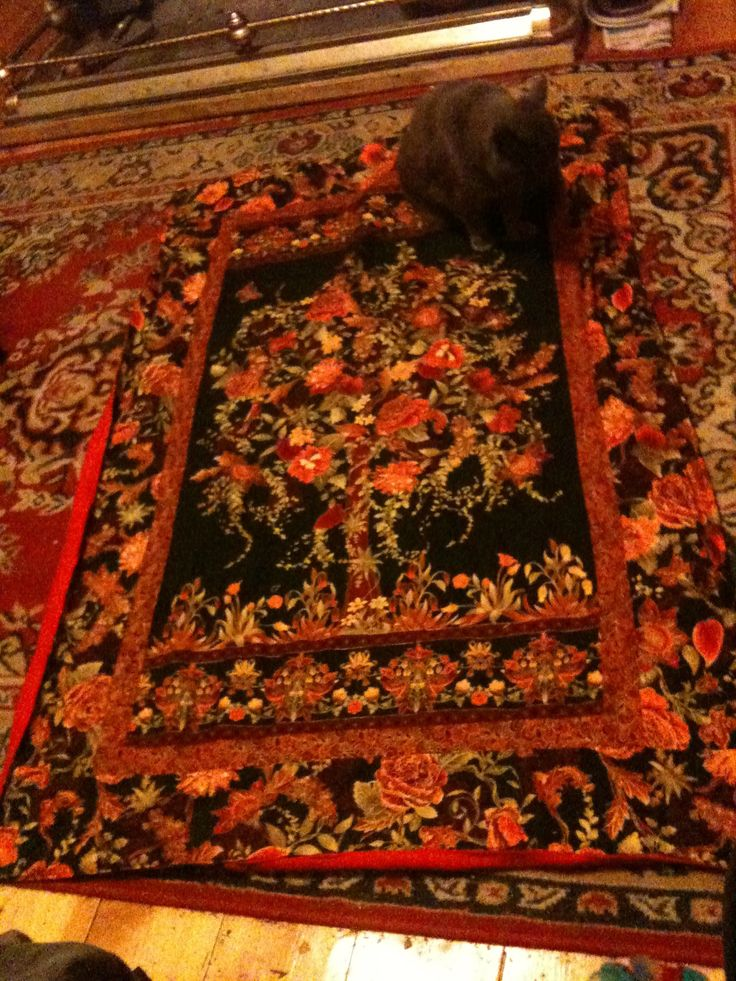 The tree of life quilt phlox the cat wouldn't let me take the photo without him backed this with red minky like fabric