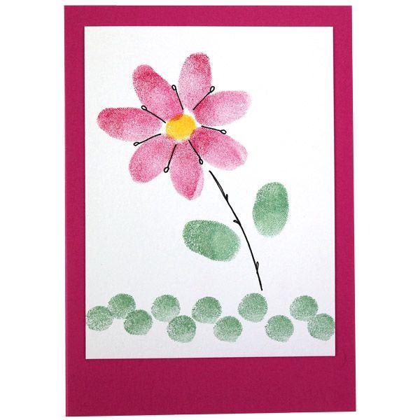 Kaunis kukkanen on leimailtu sormin ja pikkuisten VersaColor-leimasintyynyjen avulla. Tarvikkeet ja ideat Sinellistä!