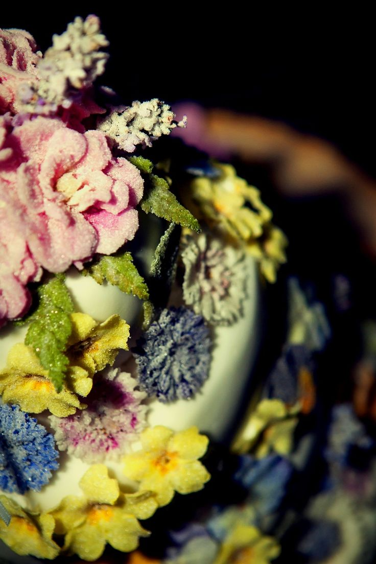 Close up of crystallised flowers wedding cake decoration - Meadowsweer Flowers.