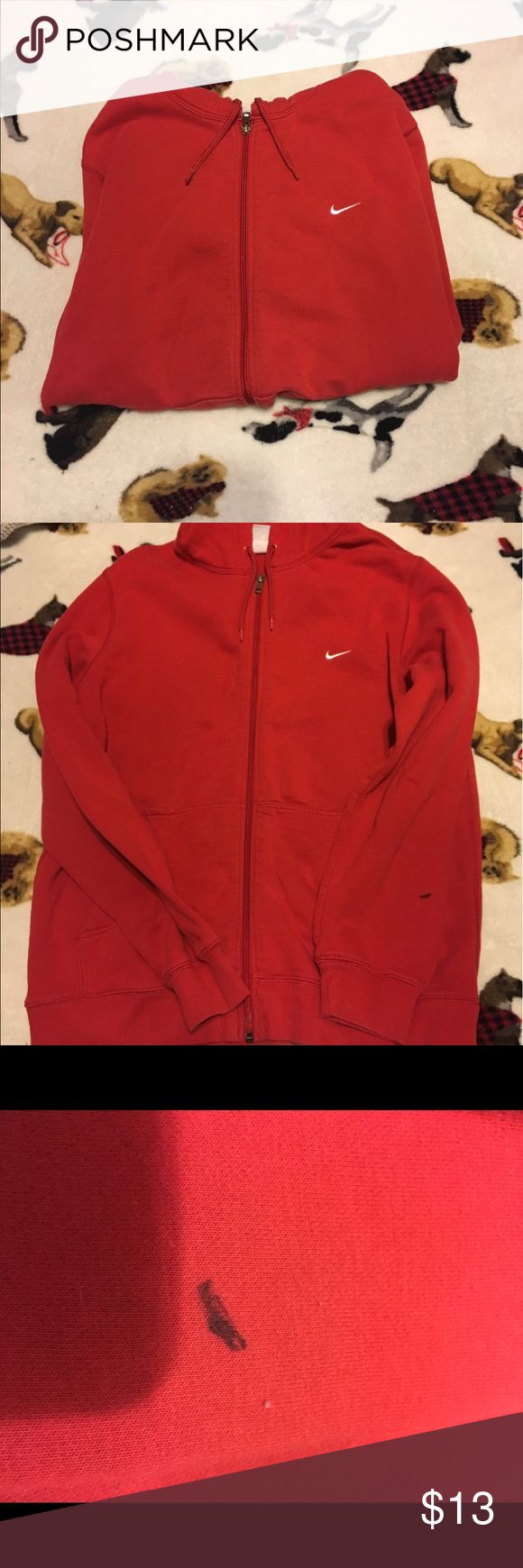 Red Nike zip up hoodie. This hoodie is in very good condition other than having a sharpie mark on the sleeve but I'm sure somebody with some good laundry skills can get it out. Comes from a smoke free home but pet friendly. No holes rips or tears. Nike Jackets & Coats
