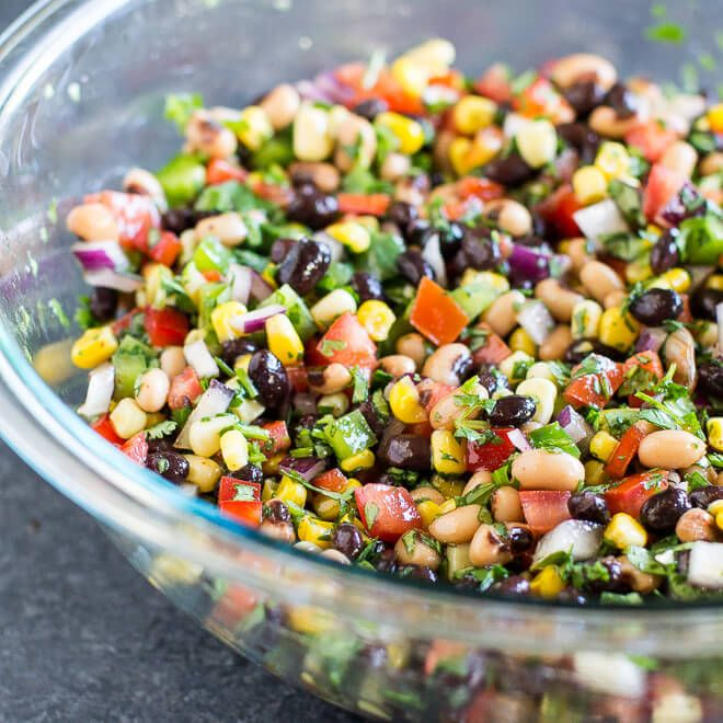Cowboy Caviar Recipe with olive oil, sugar, white wine vinegar, chili powder, salt, roma tomatoes, black-eyed peas, black beans, sweet corn, purple onion, green bell pepper, red bell pepper, chopped cilantro